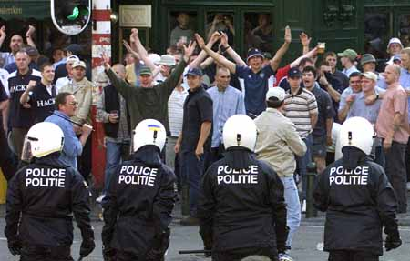 ENGLISH HOOLIGANS FACE RIOT POLICE DURING RIOTS IN BRUSSELS